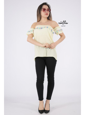 Elegant yellow blouse decorated with a style that increases your elegance