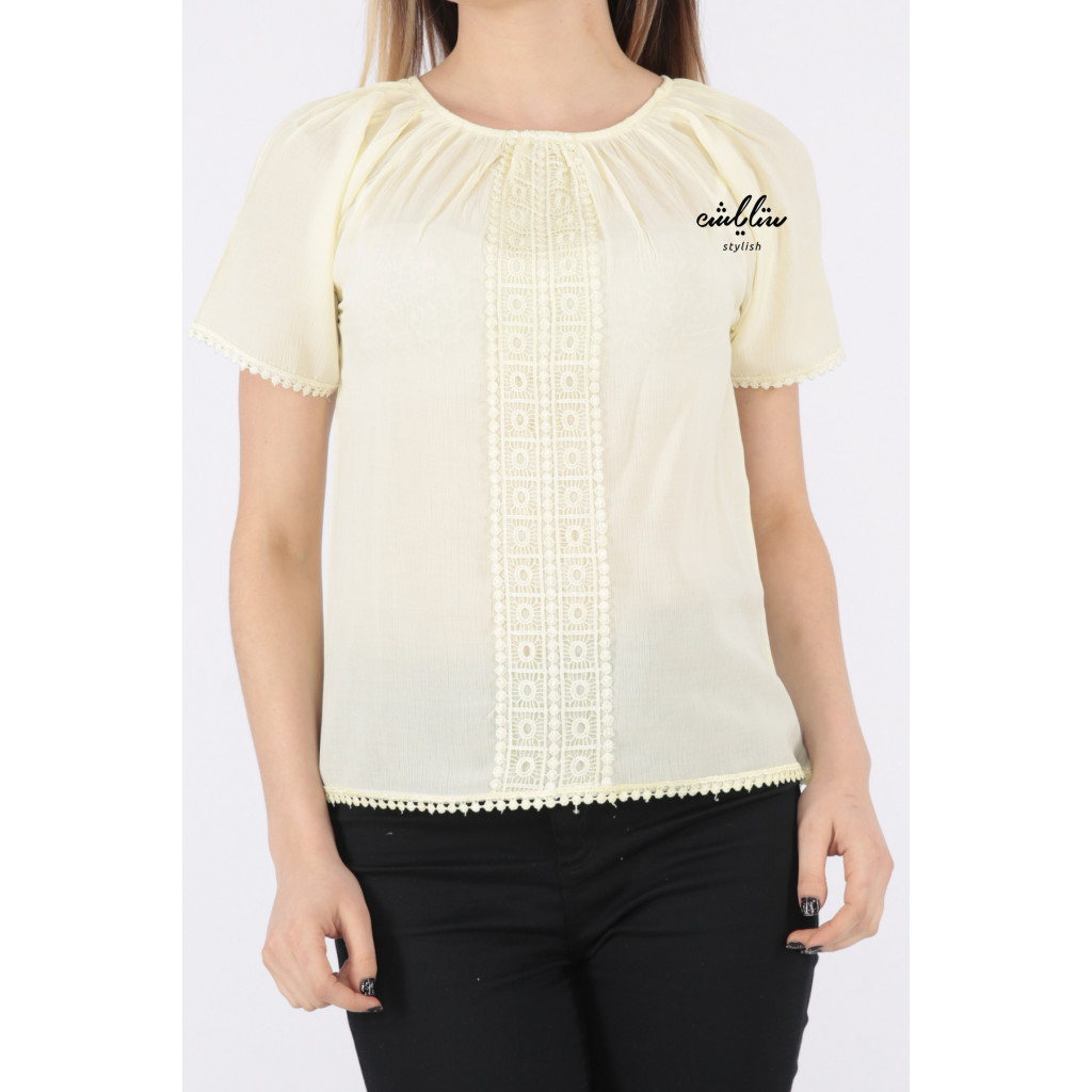 Soft yellow blouse with a touch of lace