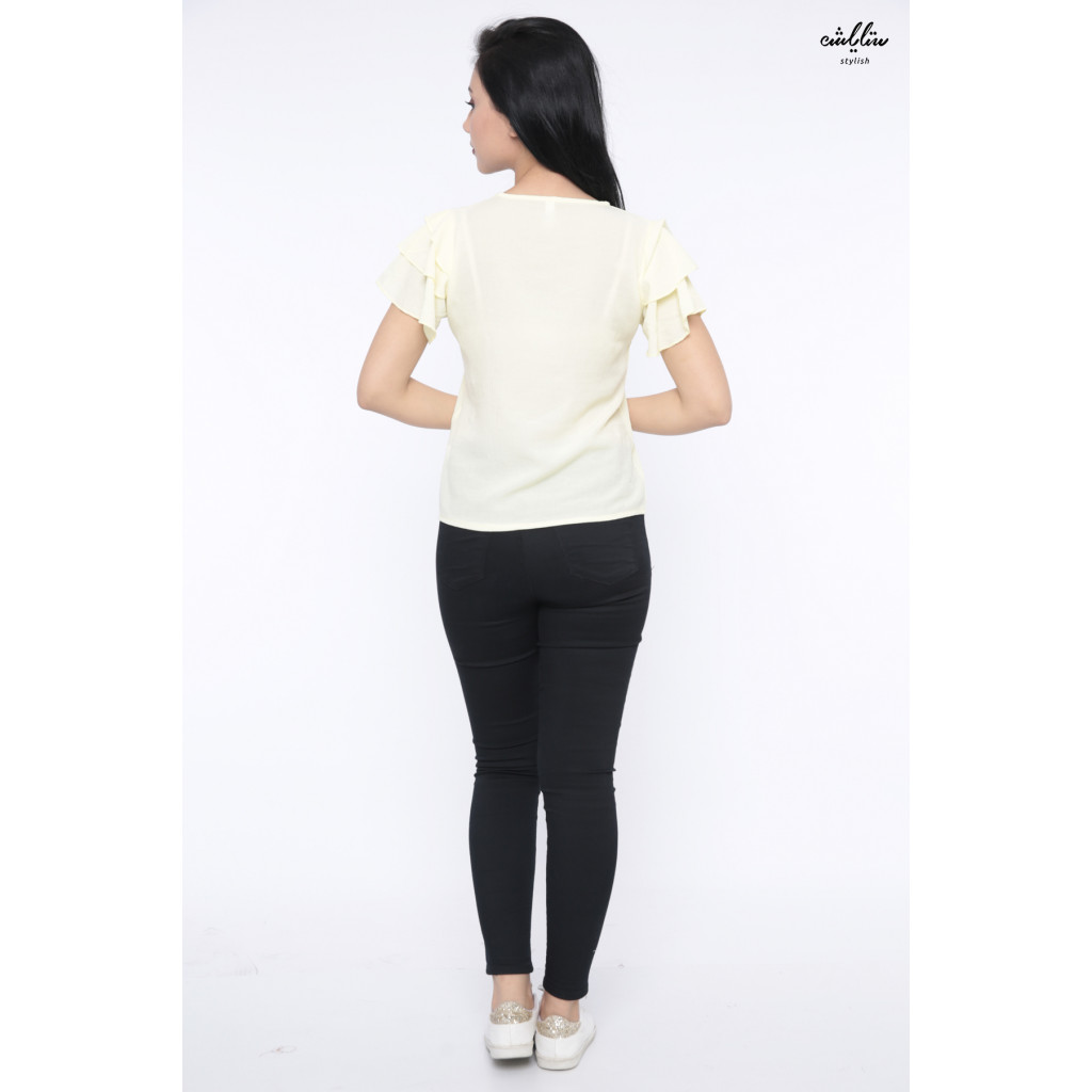 Yellow blouse with large short sleeves decorated with pearls