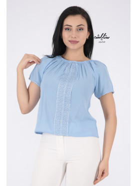Soft sky blouse with a touch of lace