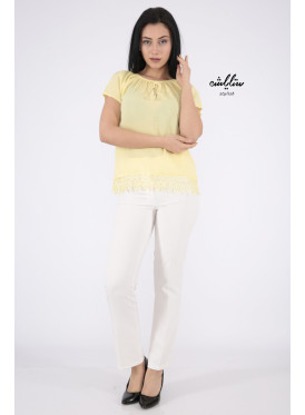 Elegant yellow blouse with bare shoulders decorated with lace