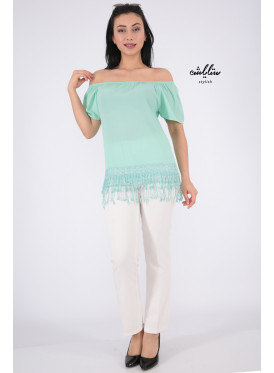Soft light green blouse with sleeves of schulder decorated with edges