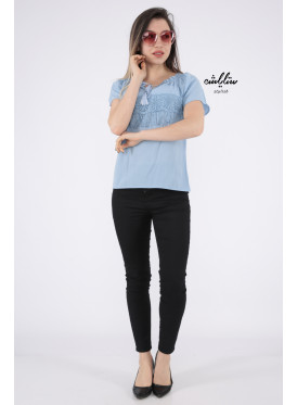 Elegant cyan blouse decorated with lace