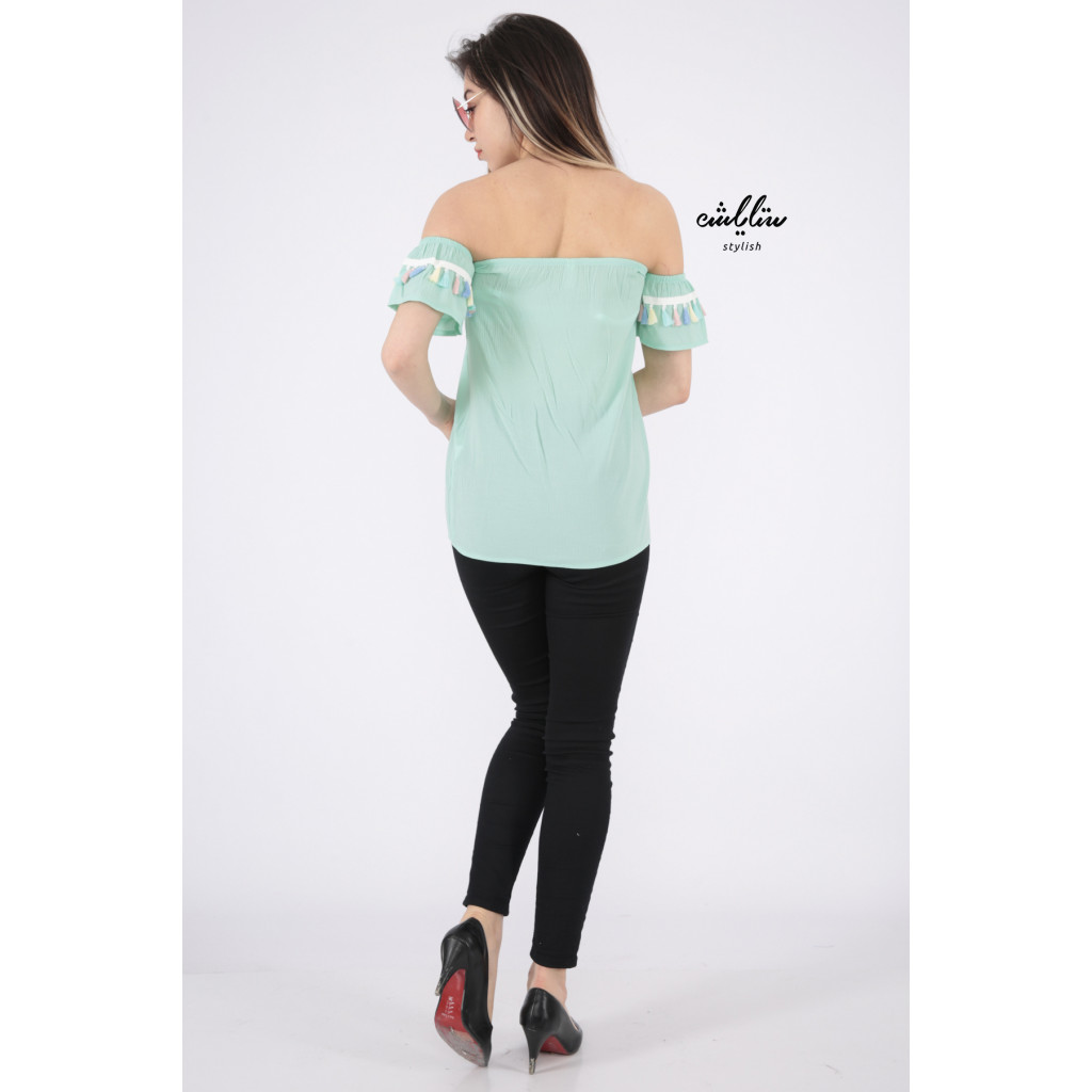 Elegant light green blouse decorated with a style that increases your elegance