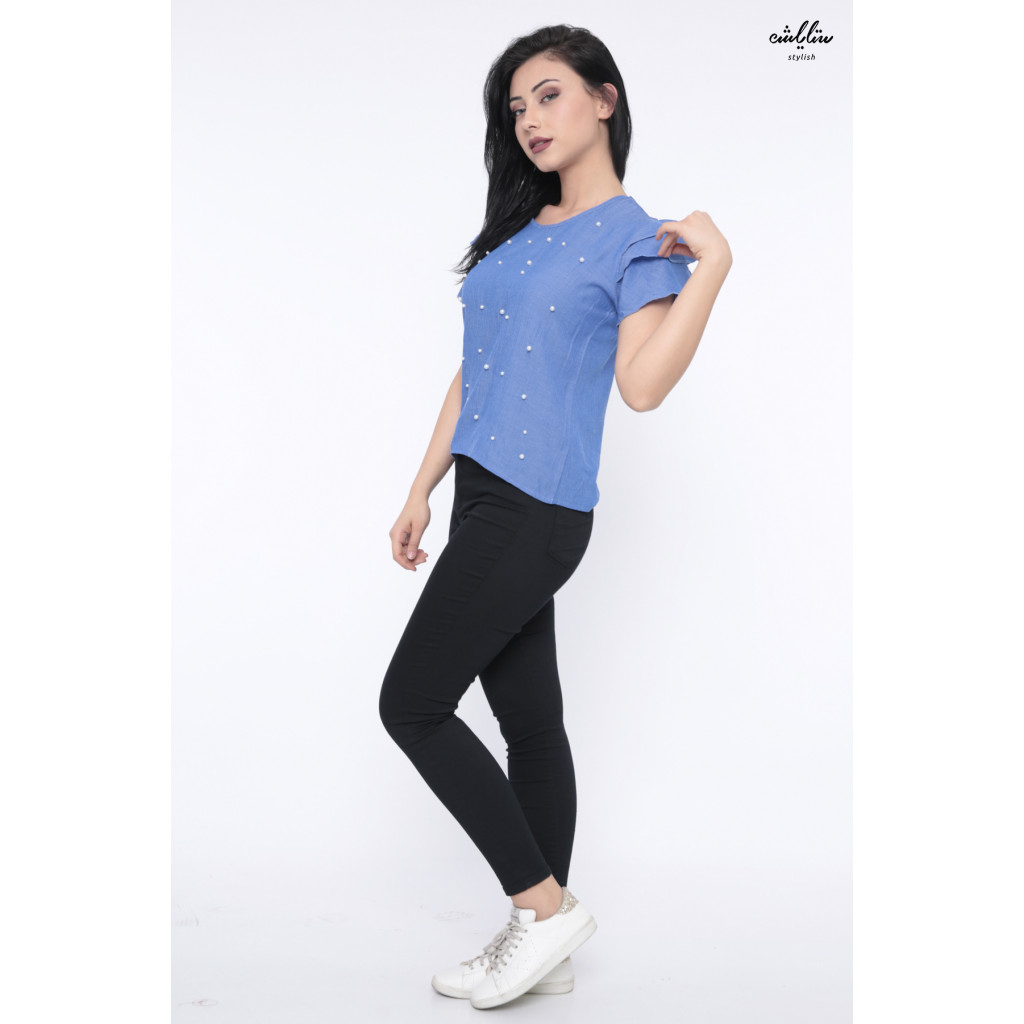 Soft blue blouse with large short sleeves decorated with pearl granules