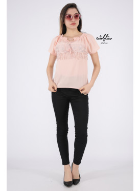 Elegant pink blouse decorated with lace