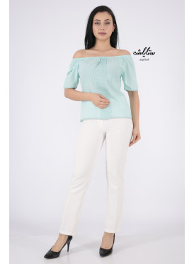 Soft green blouse with a touch of lace