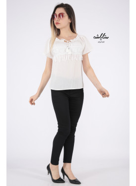 Elegant white blouse decorated with lace