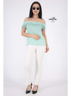 Blouse in green light with you from the top decorated with lace strap and pearl beads