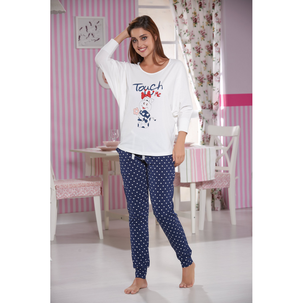 A very soft set of two pieces in white and navy trousers decorated with heart prints
