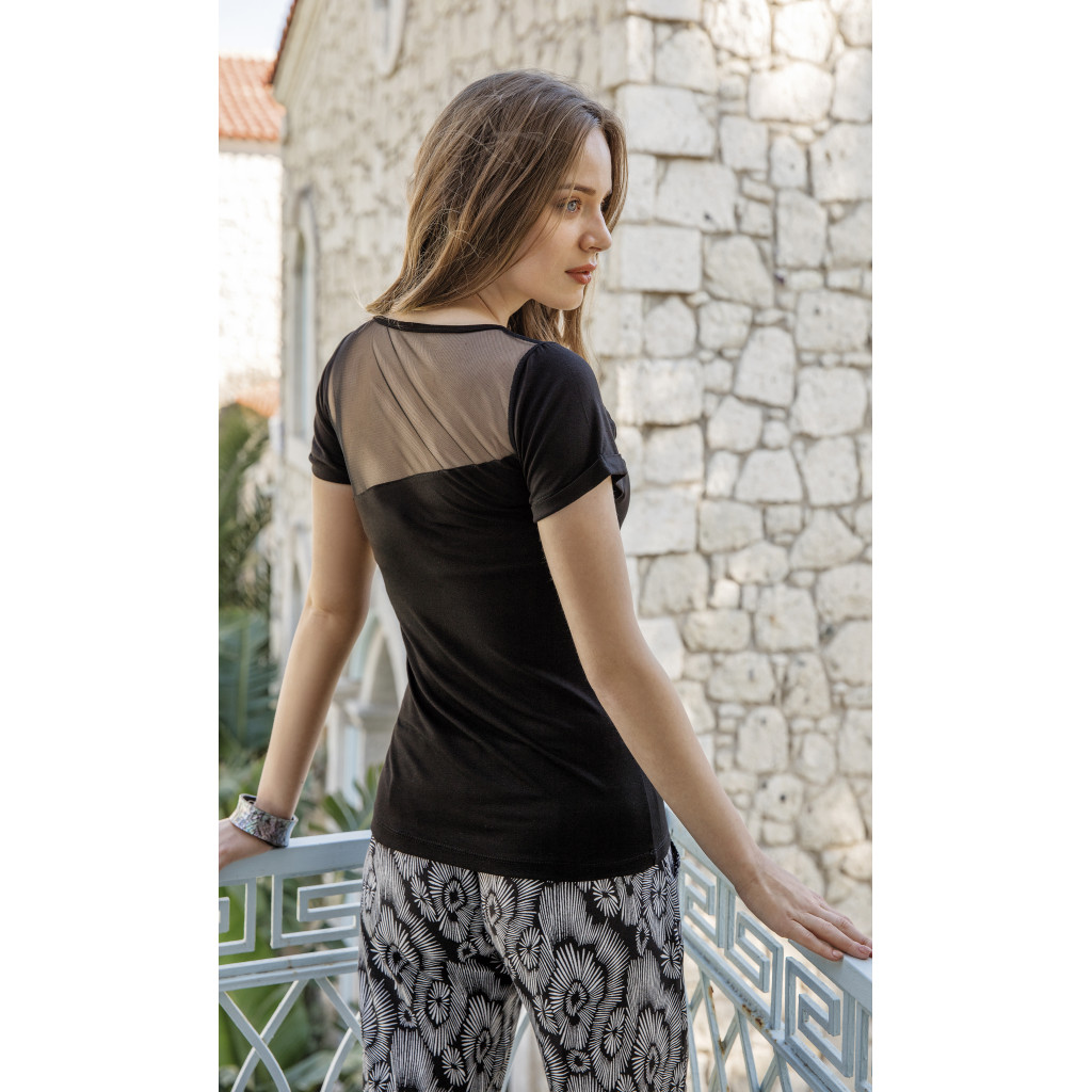 Ultra-stylish set of two pieces black top, luxurious textured trousers, soft and comfortable skin texture