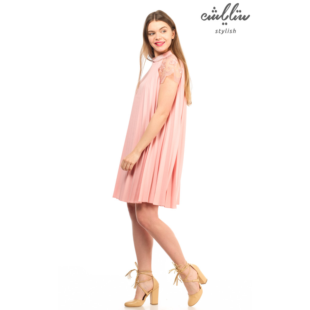 Elegant pink mini dress with lace sleeves decorated with lace slacks for a soft feminine look