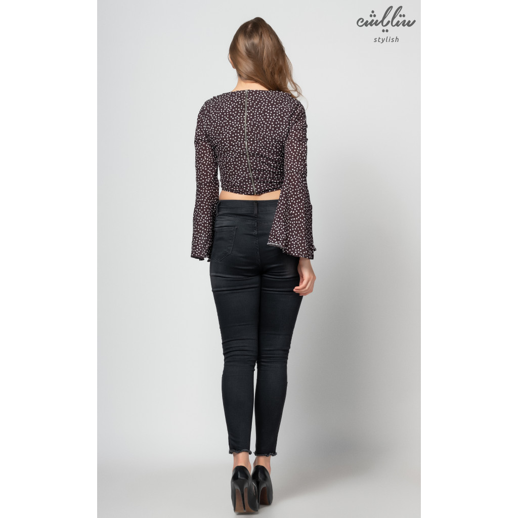 A soft black blouse with a charming crisp-style polka dots