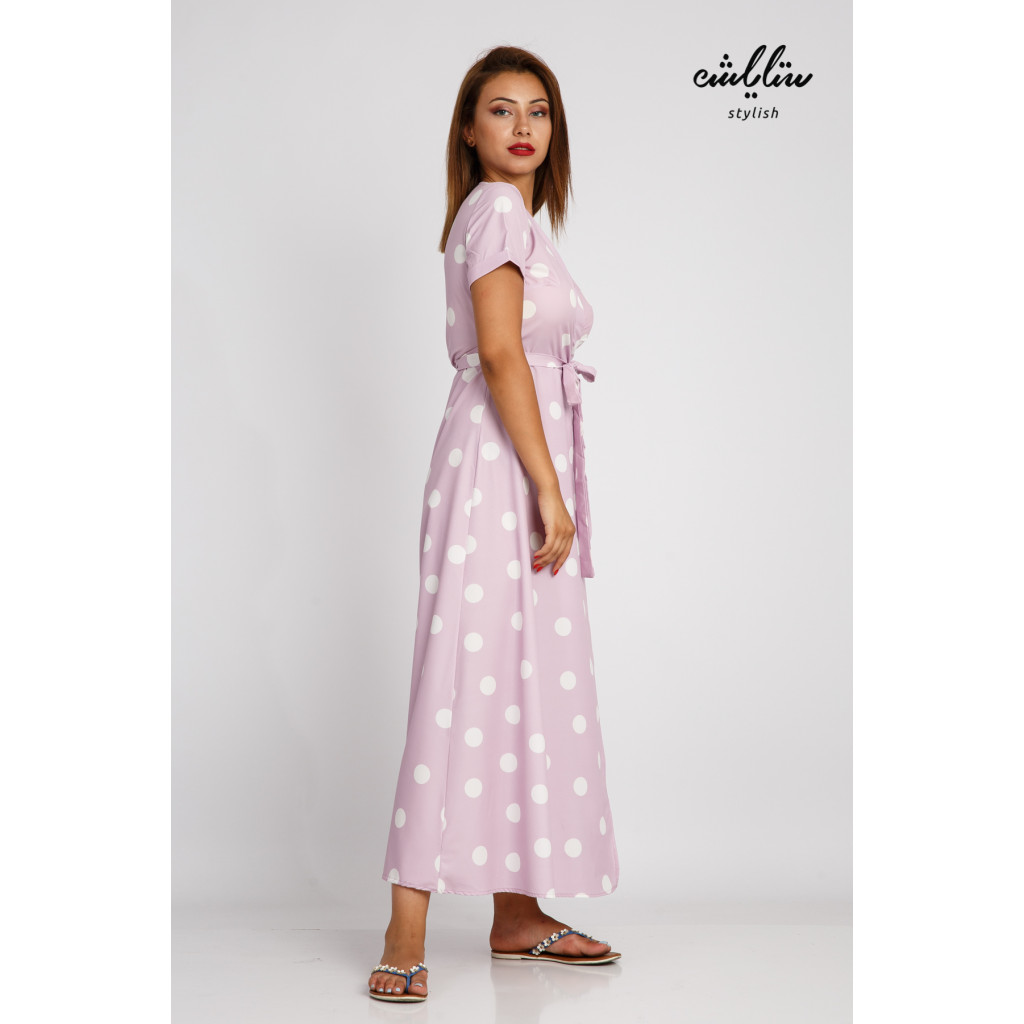 Soft and elegant pink maxi dress with a wrap-and-dotted pattern with a strap on the waist