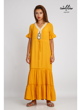 A light mango maxi dress decorated with soft plungs and a strap on the waist, practical and comfortable