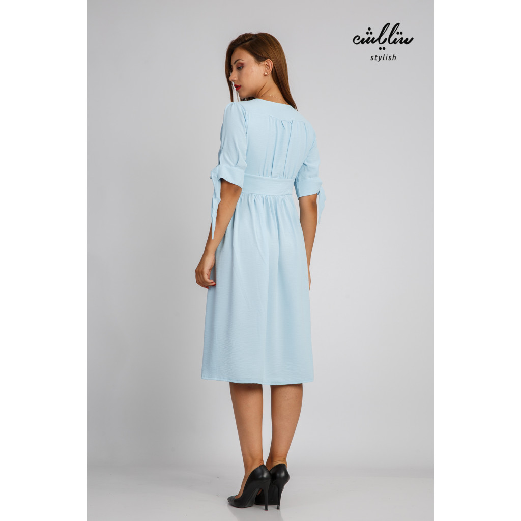 A soft, sky-high casual dress decorated with buttons in an attractive style and a modern cut
