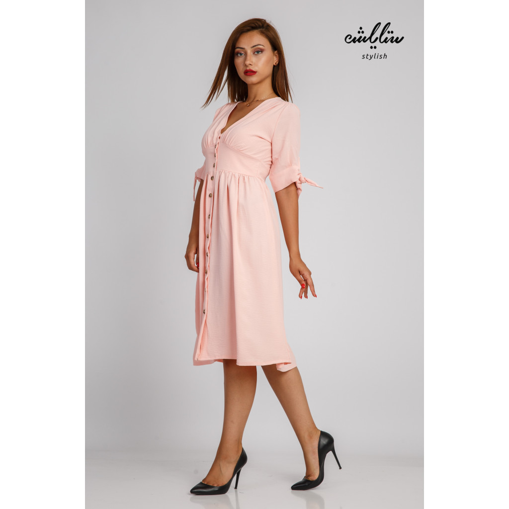 Soft baby pink mini dress with front buttons and an innovative cut for a feminine look
