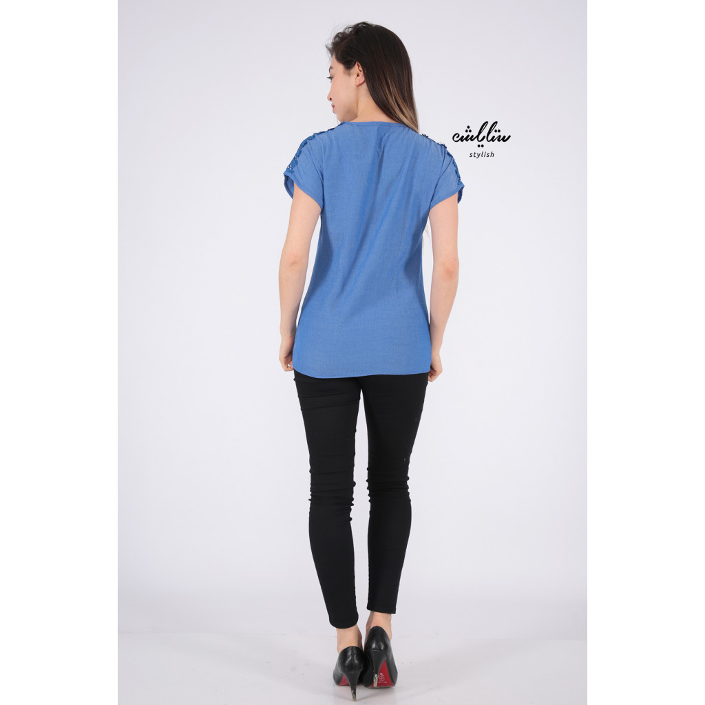 Elegant blue blouse decorated with a distinctive view
