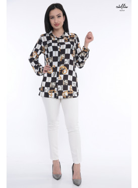 Elegant black and white blouse with golden decoration that adds elegance