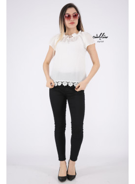Chic off-the-shoulder blouse in white decorated with lace