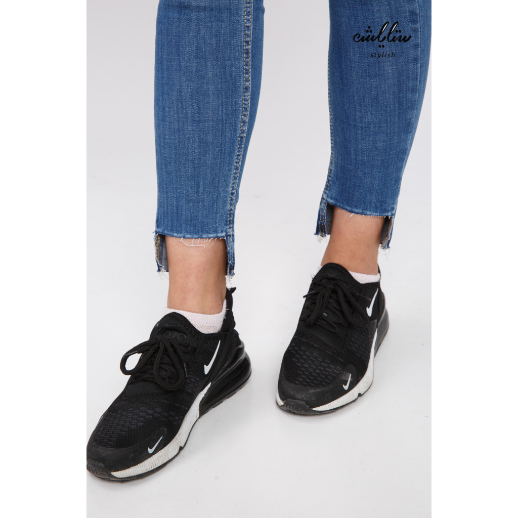 Stylish jeans decorated with leather strap and innovative edges