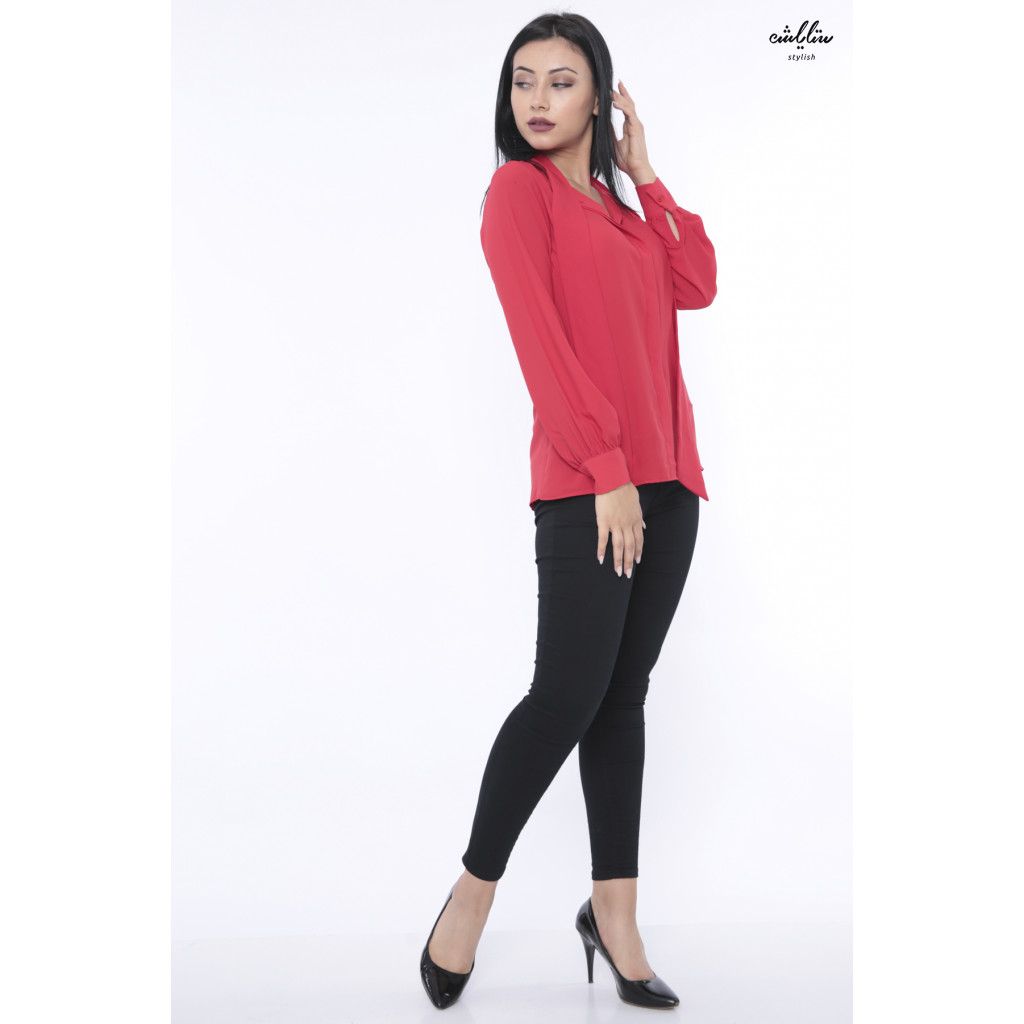 A soft blouse in red with a long neck and a high collar with a tie to give an elegant touch