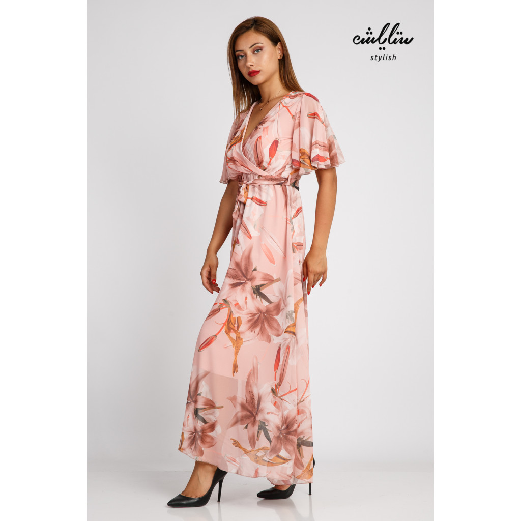 A powder-colored maxi dress with beautiful, soft and elegant bushes