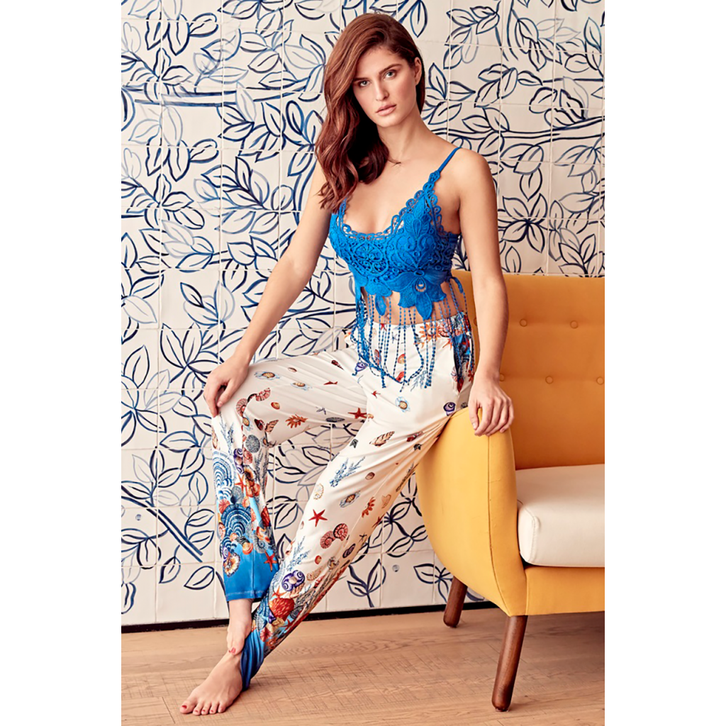 A very soft, blue top set with beautiful prints and crisp summer shorts.